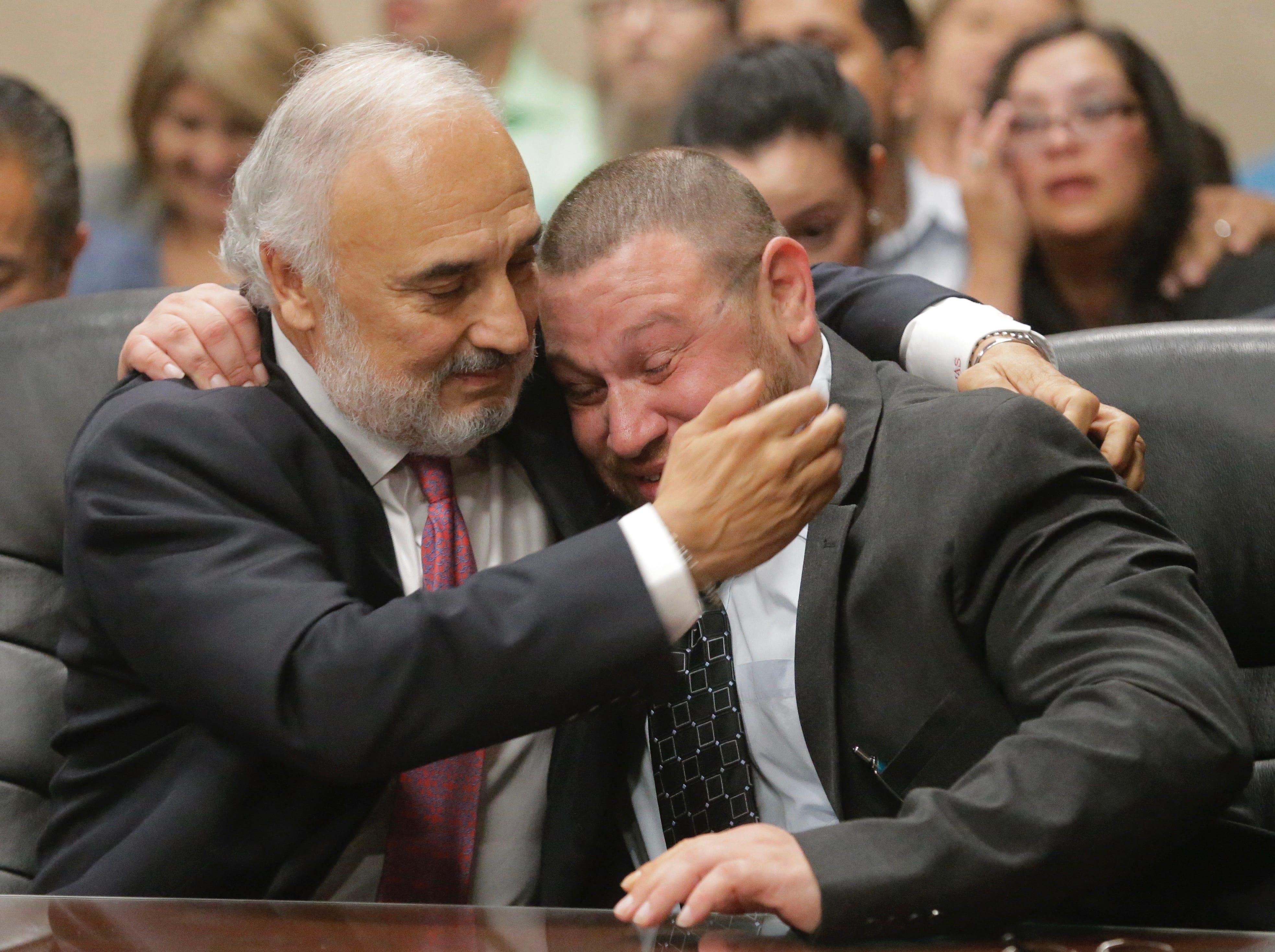 Defense attorney Joe Spencer hugs Daniel Villegas after the verdict was read.