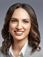Valerie Elaine Carlos , mortgage loan officer at Western Heritage Bank.