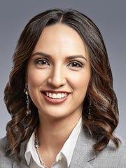 Valerie Elaine Carlos , mortgage loan officer at Western Heritage Bank.