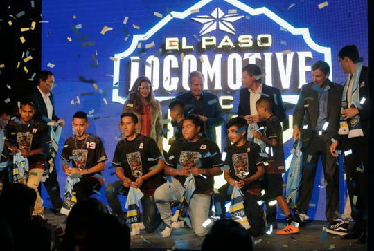 Officials from the MountainStar Sports Group stand on stage at the EPIC Railyard Event Center as the official name of El Paso's USL team was announced. The name chosen from the final five was El Paso Locomotive FC.