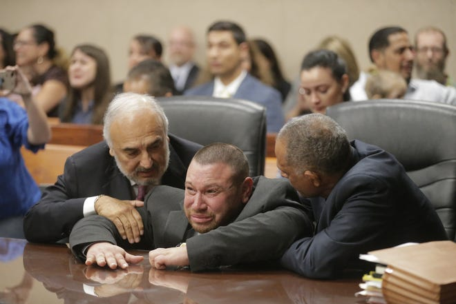 Daniel Villegas collapses after Judge Sam Medrano reads the verdict in Villegas' third trial for capital murder: Not guilty.