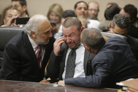 Daniel Villegas wipes aways tears and is congratulated by his attorneys, Joe Spencer (left) and Felix Valenzuela, after the verdict in his trial was read. Villegas was found not guilty after his third trial for capital murder.