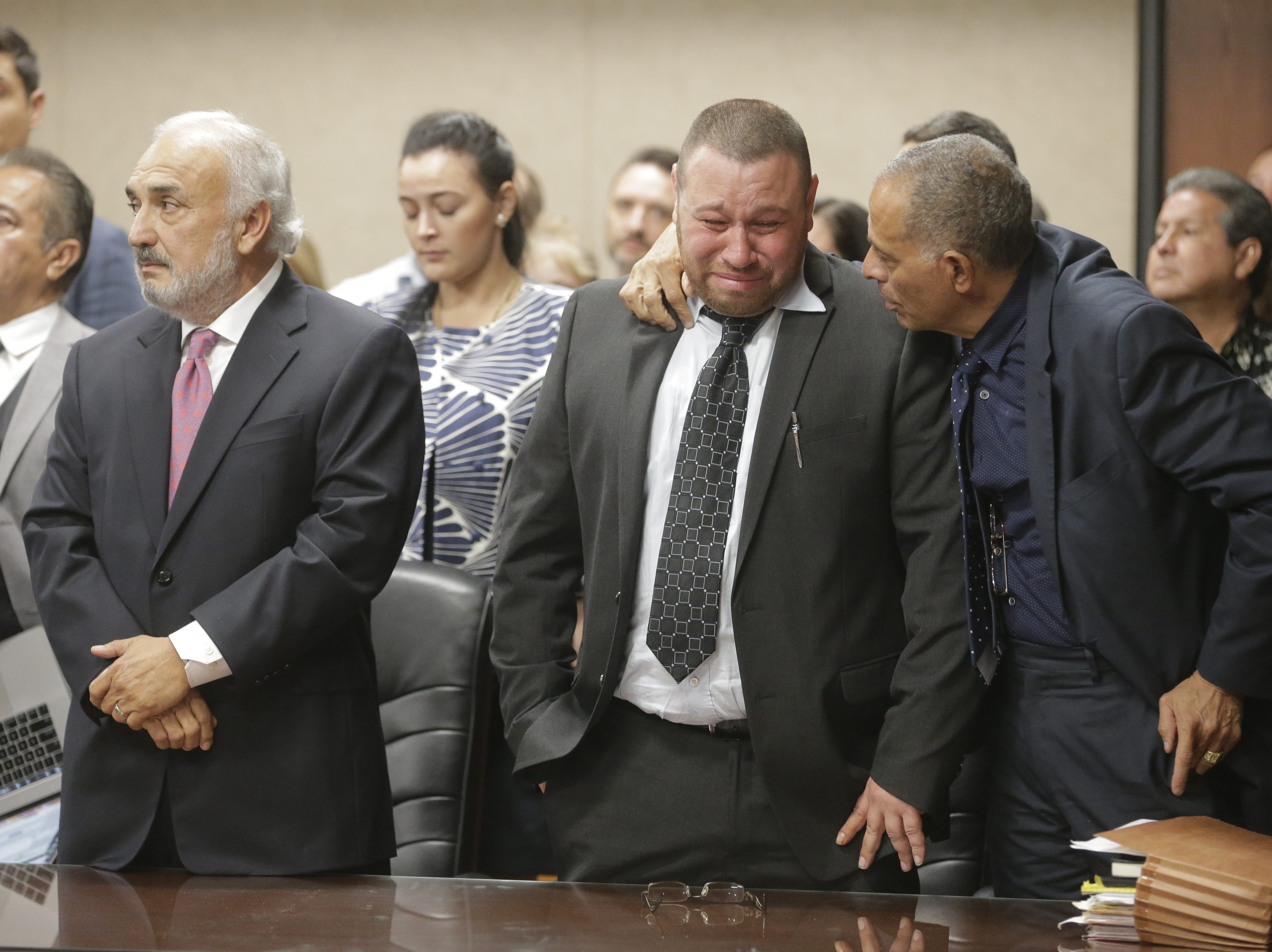 Daniel Villegas' attorney Felix Valenzuela puts his arm around Villegas after the not guilty verdict was read in court Friday.