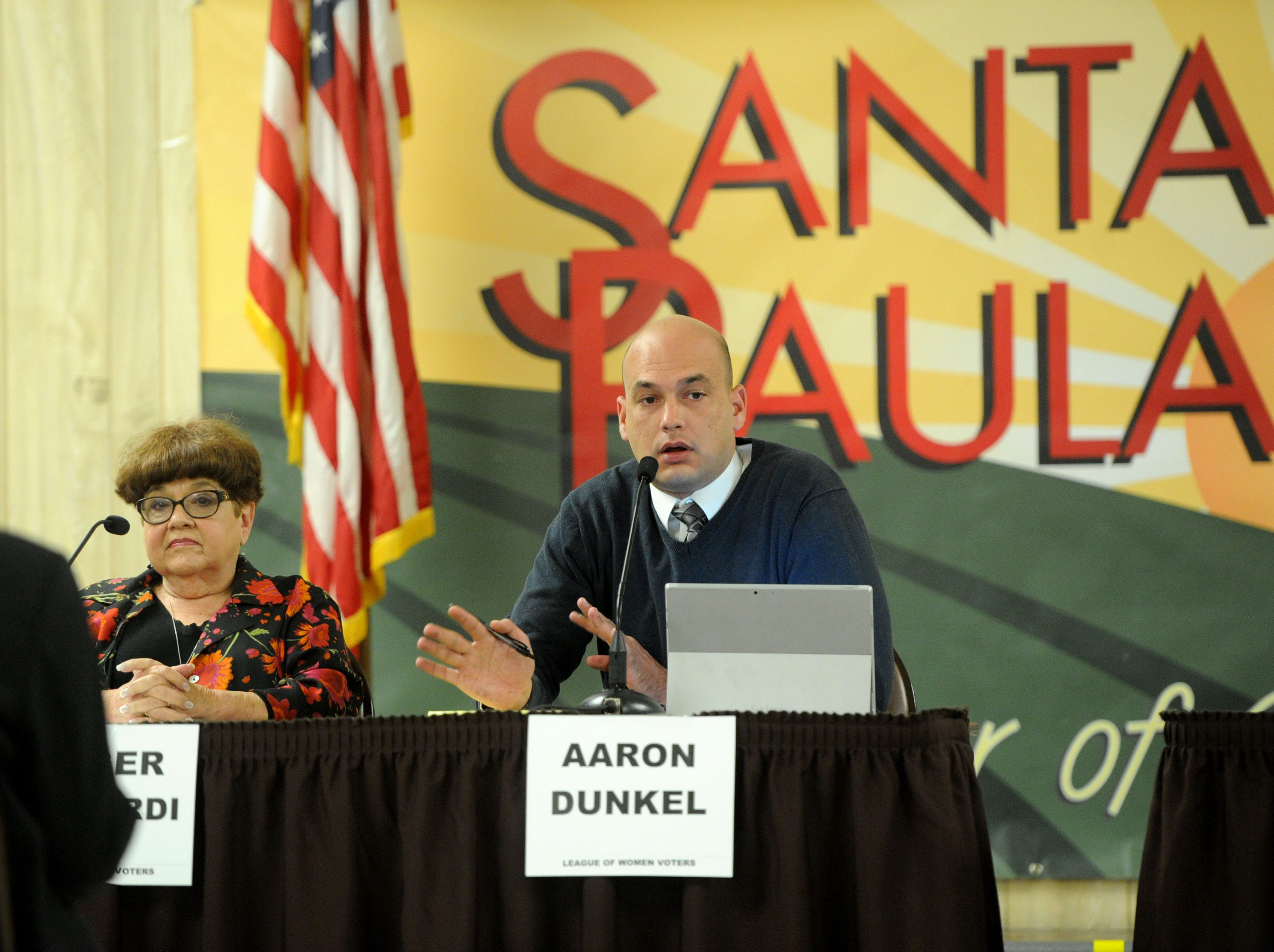 Aaron Dunkel answers a question about how to pay for a new park as Ginger Gherardi listens on. The two are among six candidates vying for three seats on the Santa Paula City Council.
