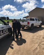 An Oxnard police officer arrests Felipe De Los Reyes, 28, of Oxnard, on suspicion of vehicle theft.