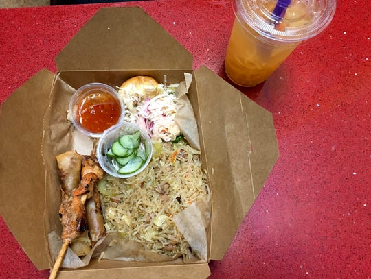 At Mestiza Kitchen, the MK combo, $10, includes Imperial Noodles, two lumpia, a chicken skewer and an adobo slider. Also pictured is cantaloupe juice, featuring shredded melon.