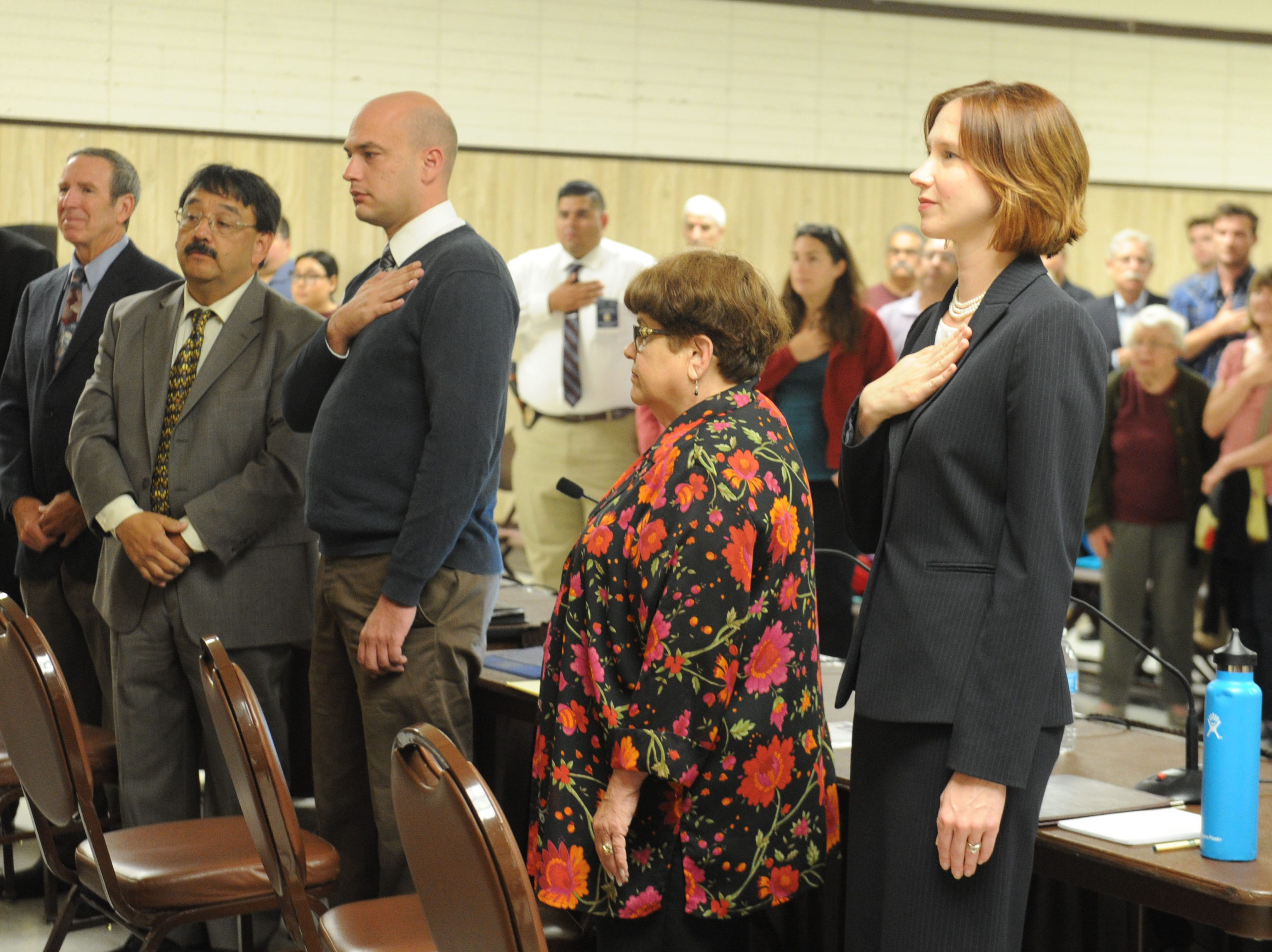 From left, Richard Araiza, Andy Sobel, Carlos Juarez, Aaron Dunkel, Ginger Gherardi and Jenny Crosswhite stand for the Pledge of Allegiance at the beginning of a Santa Paula City Council candidates forum.