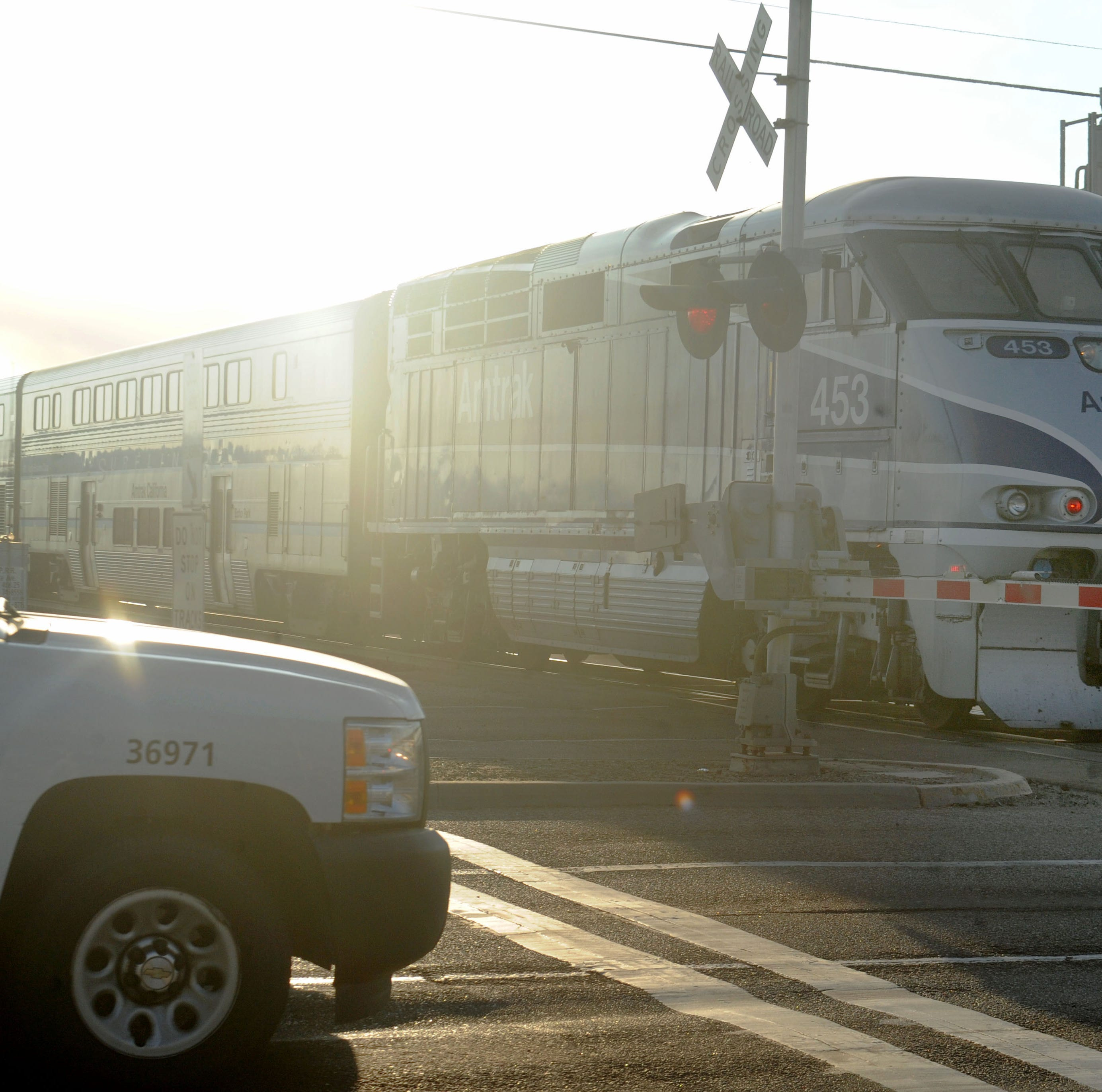 An Amtrak train passes through Rice Avenue and East Fifth Street on an early morning route. The crossing was the scene of a deadly truck vs. train crash on Feb. 24, 2015. That crash led to increased calls for a new bridge and $68.6 million has been promised to build it. But if Proposition 6 passes in November that money would vanish.