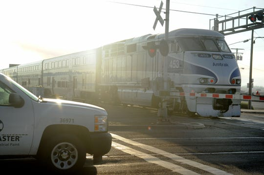 A morning train passes through the Rice Avenue and East Fifth Street intersection in Oxnard. If approved by voters on Nov. 6, Proposition  6 would repeal SB1, the Road Repair and Accountability Act. That repeal would deprive Ventura County of millions of dollars for transit projects, including a long-planned bridge that would lift Rice Avenue over the railroad tracks near East Fifth Street, site of a 2015 deadly train vs. truck collision. Proposition 6 backers say Californians are over-taxed.