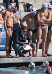 Oaks Christian head coach Jack Kocur talks with his players during their boys water polo match against Westlake High on Thursday. After starring at Royal High and Pepperdine, Kocur coached at Pepperdine and part of the U.S. National Team's coaching staff.