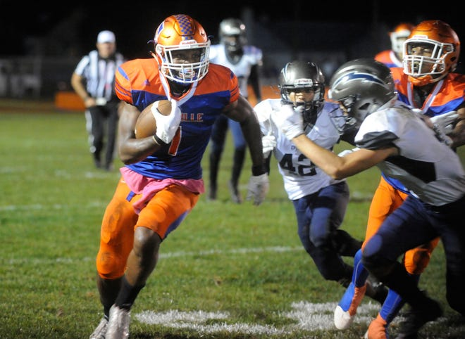 Millville's Solomon DeShields (1) runs for a gain during a game against visiting Timber Creek on Friday, October 5, 2018.