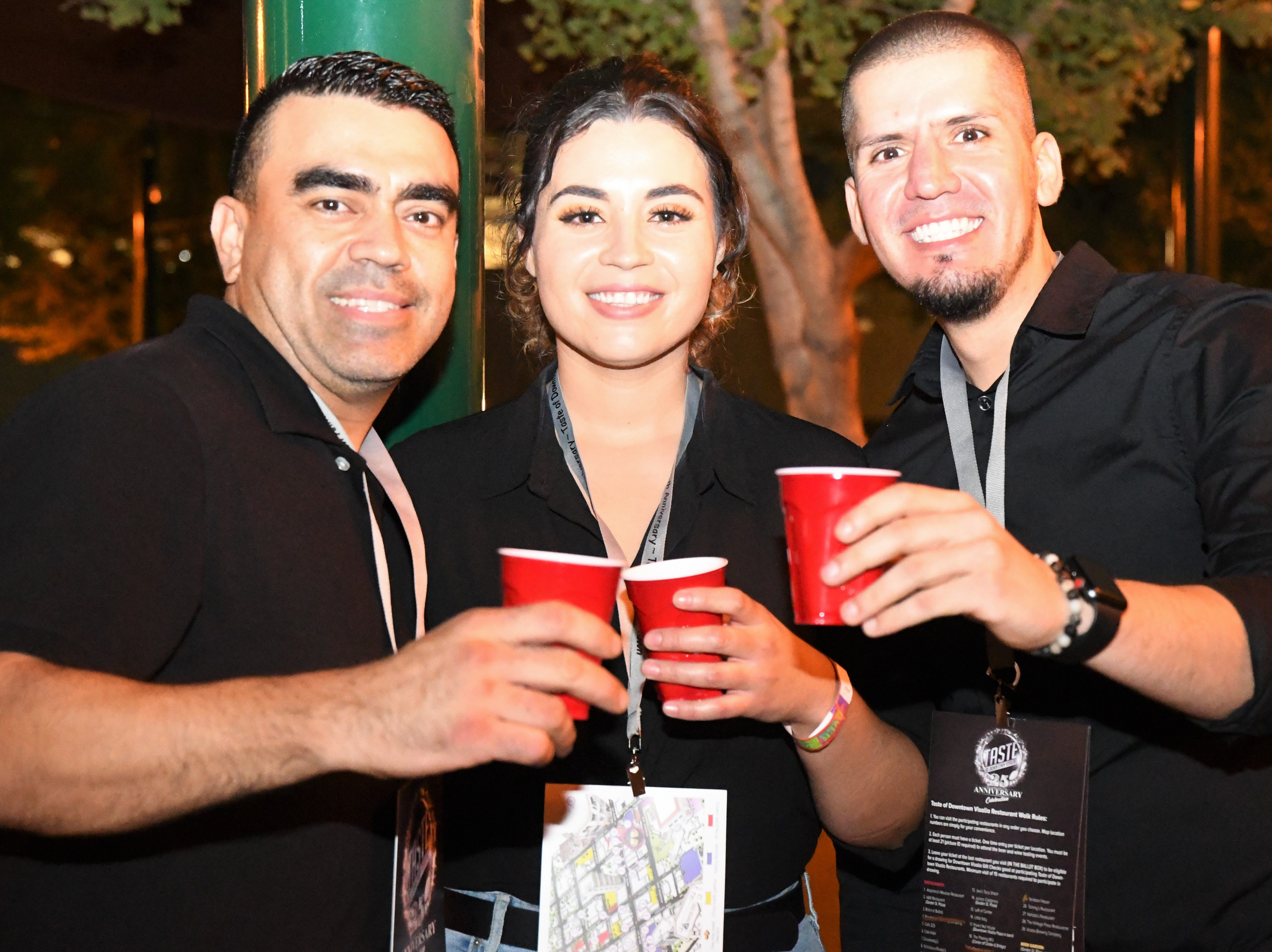 Alejandra's emplyees enjoy a hard-earned beer after happily serving countless hungry Taste attendees.