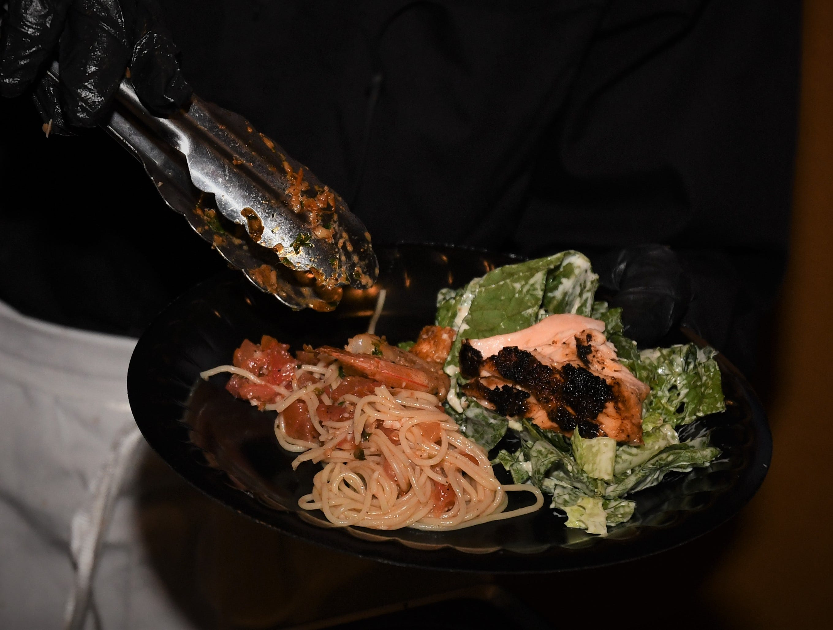 Seafood reigned at Cafe 225's Taste showing this year, with shrimp and salmon on a bed of linguine and romaine.