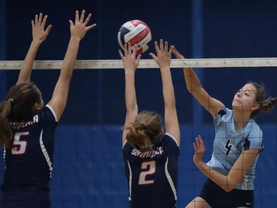 Little Chute outside hitter Hannah Vanden Berg, right, is headed to Marquette next fall. The Mustangs standout also places for the FC Elite club volleyball program.