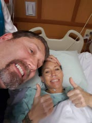Tara Mondloch's brother takes a selfie with Tara after her mastectomy surgery.