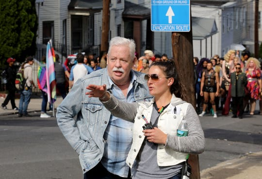 "The Nodine Hill section of Yonkers stands in for San Francisco, as the television series ""Armistead Maupin's Tales of the City"" films a scene, Oct. 5, 2018. Here author Armistead Maupin, left, chats with one of the production staffers."
