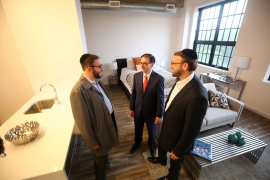 From left, Developer Sam Kaller, architect Phil Fruchter, and developer Afraim Hirsch  look over one of the models at the new Norden Lofts on Westmorland Ave in White Plains Oct. 4, 2018.