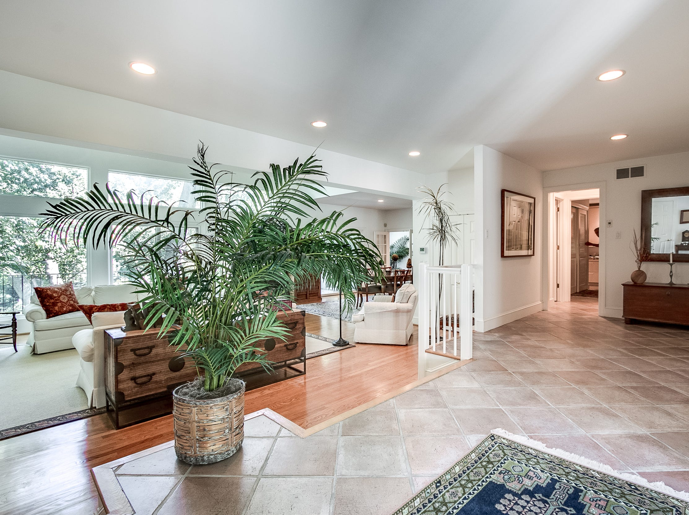 The foyer, paved in tiles, steps down to the living room at 7 Brandywine Falls in Wilmington.