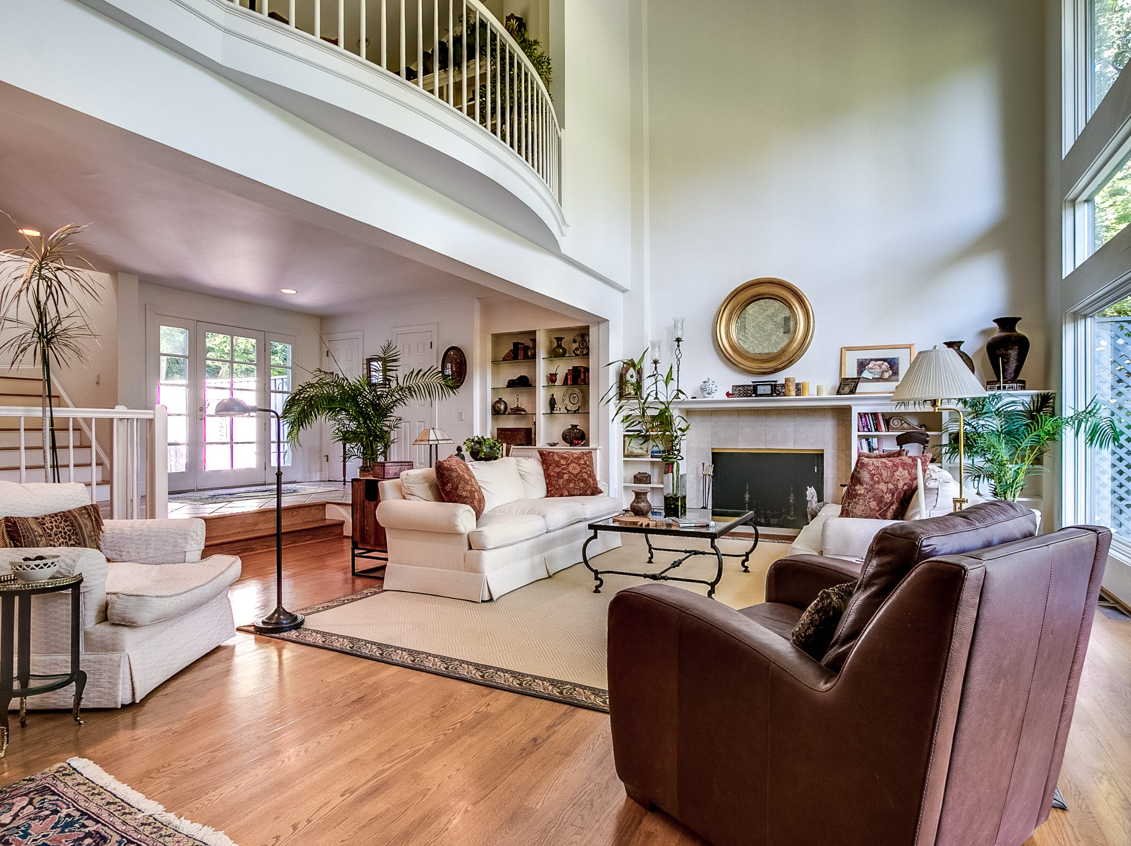 The open-concept living room is a favorite place for gatherings at 7 Brandywine Falls Road in Wilmington.