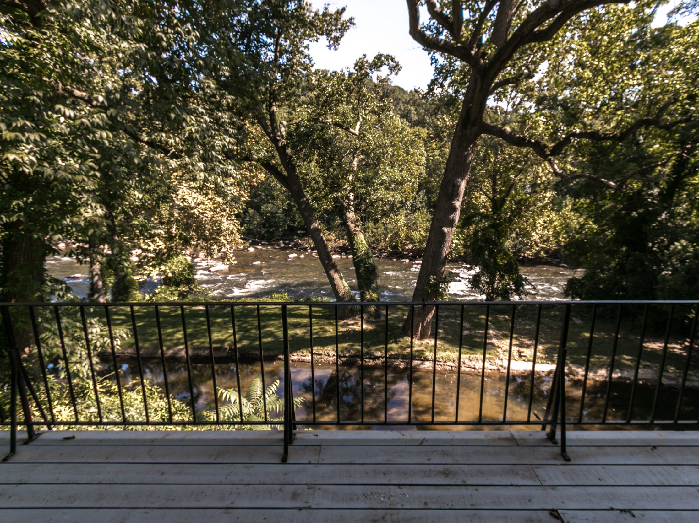 Changing seasonal views of the Brandywine River are visible from all the rooms at the back of 7 Brandywine Falls Road in Wilmington.