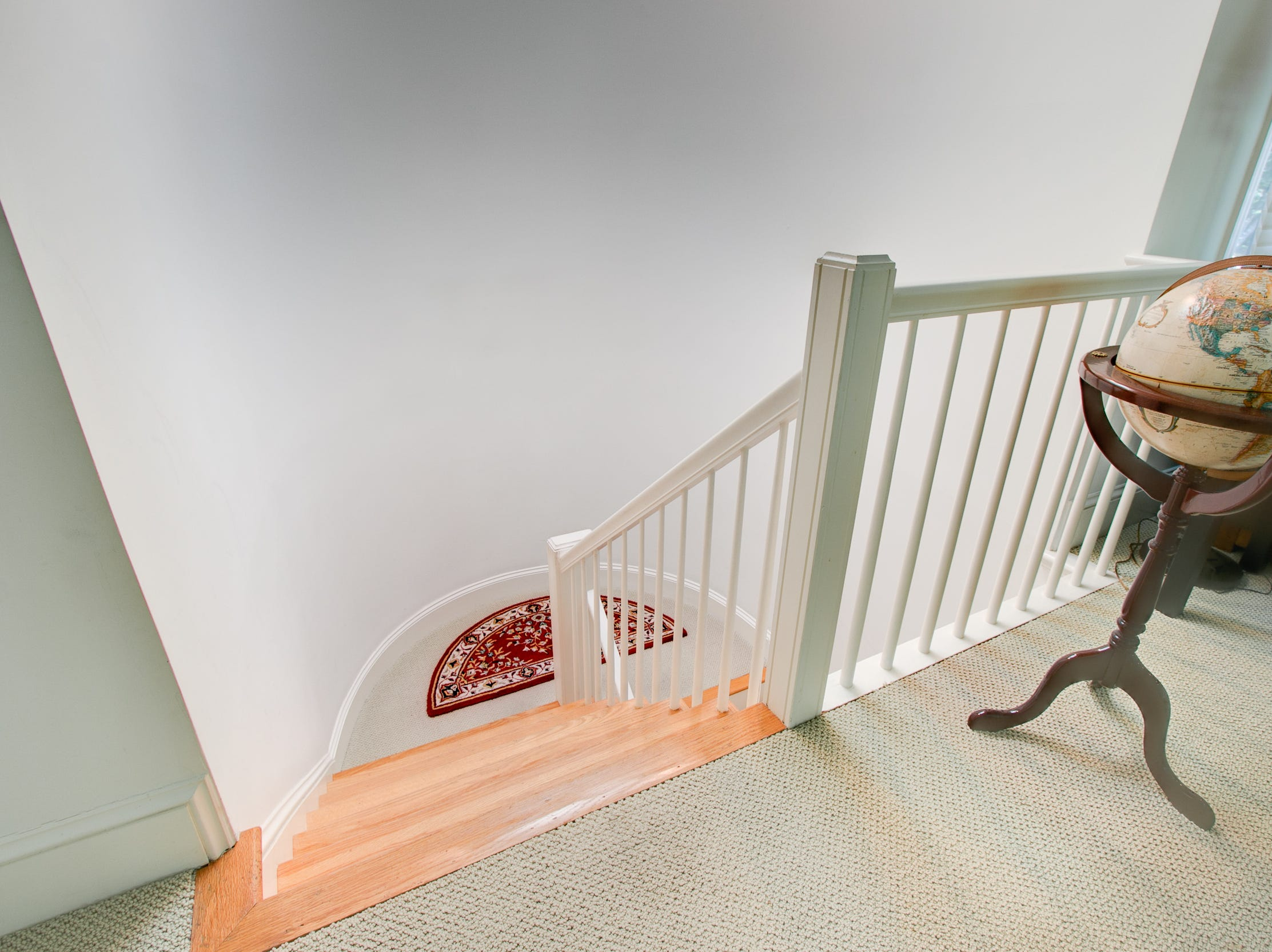A simple staircase connects the three floors at 7 Brandywine Falls Road in Wilmington.