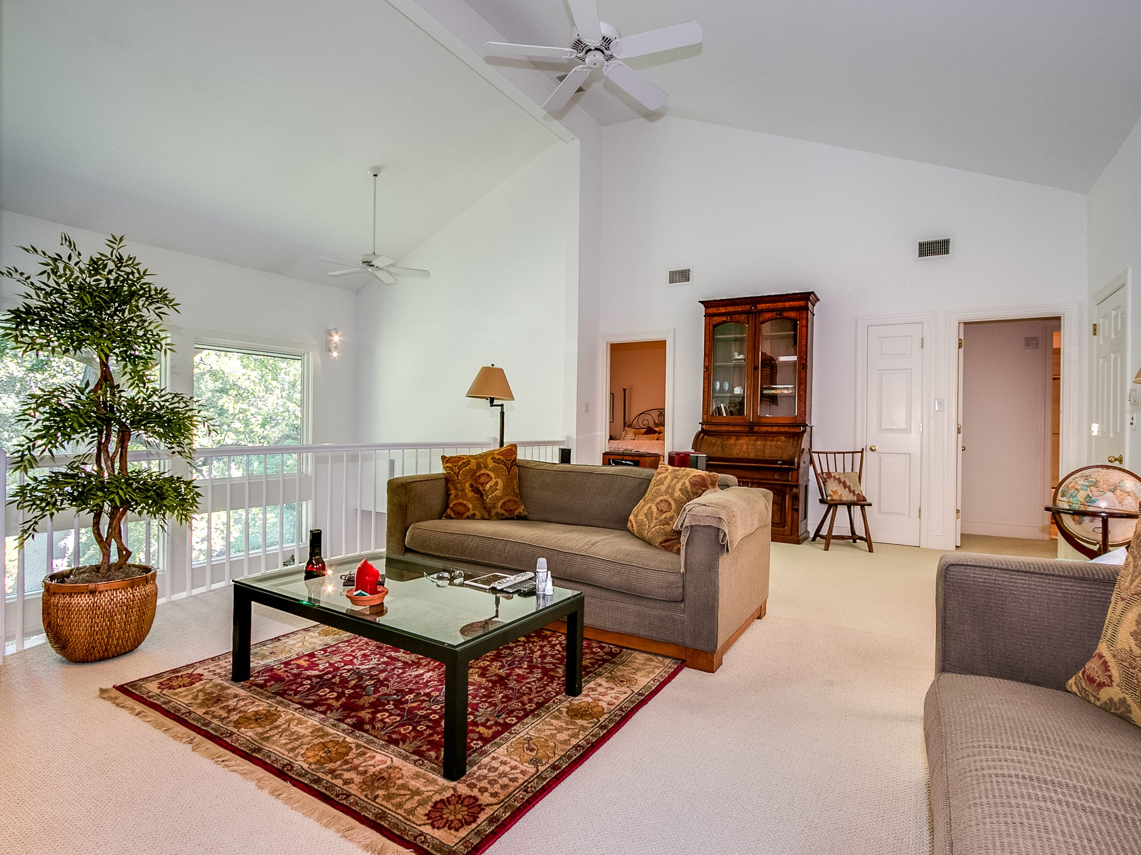 An upper level den is a comfortable place to relax at 7 Brandywine Falls Road in Wilmington.