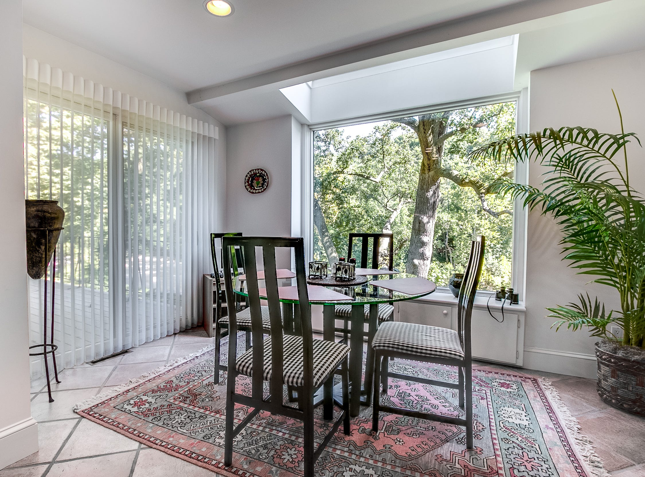 A casual dining area off the kitchen at 7 Brandywine Falls Road in Wilmington has a large window with a view.
