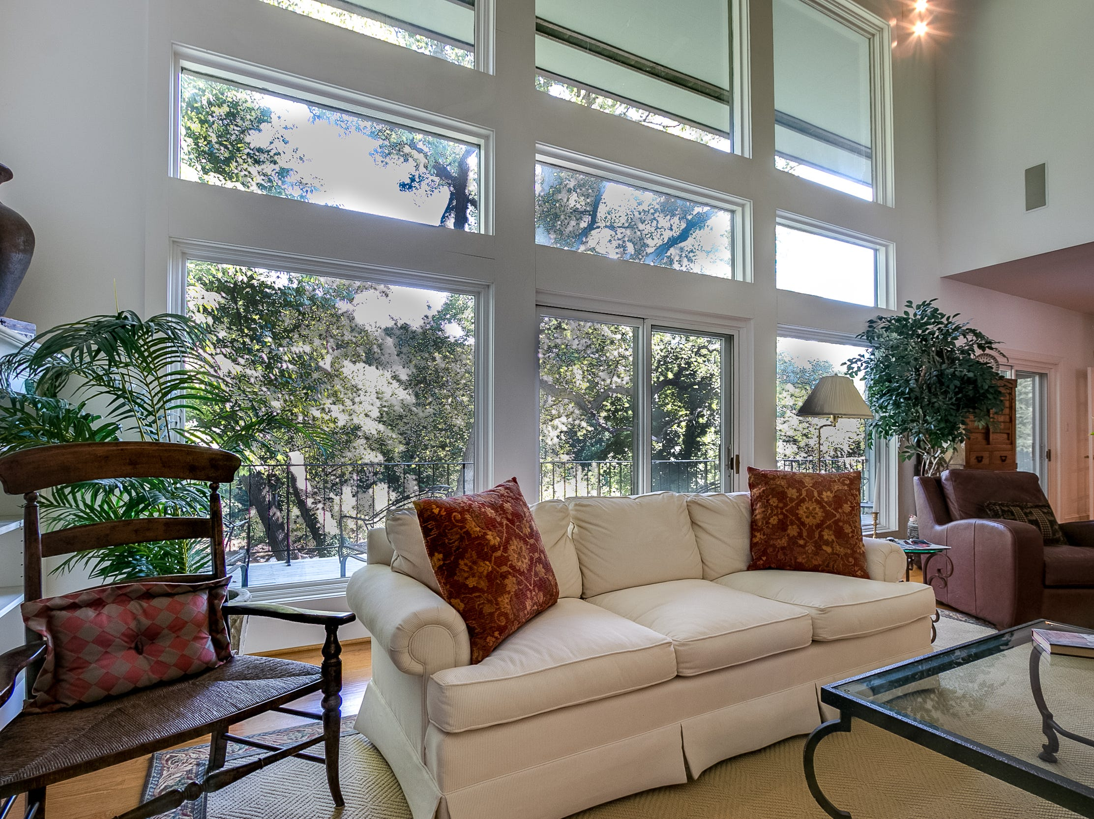 A wall of windows allows the outdoors into the living room at 7 Brandywine Falls Road in Wilmington.