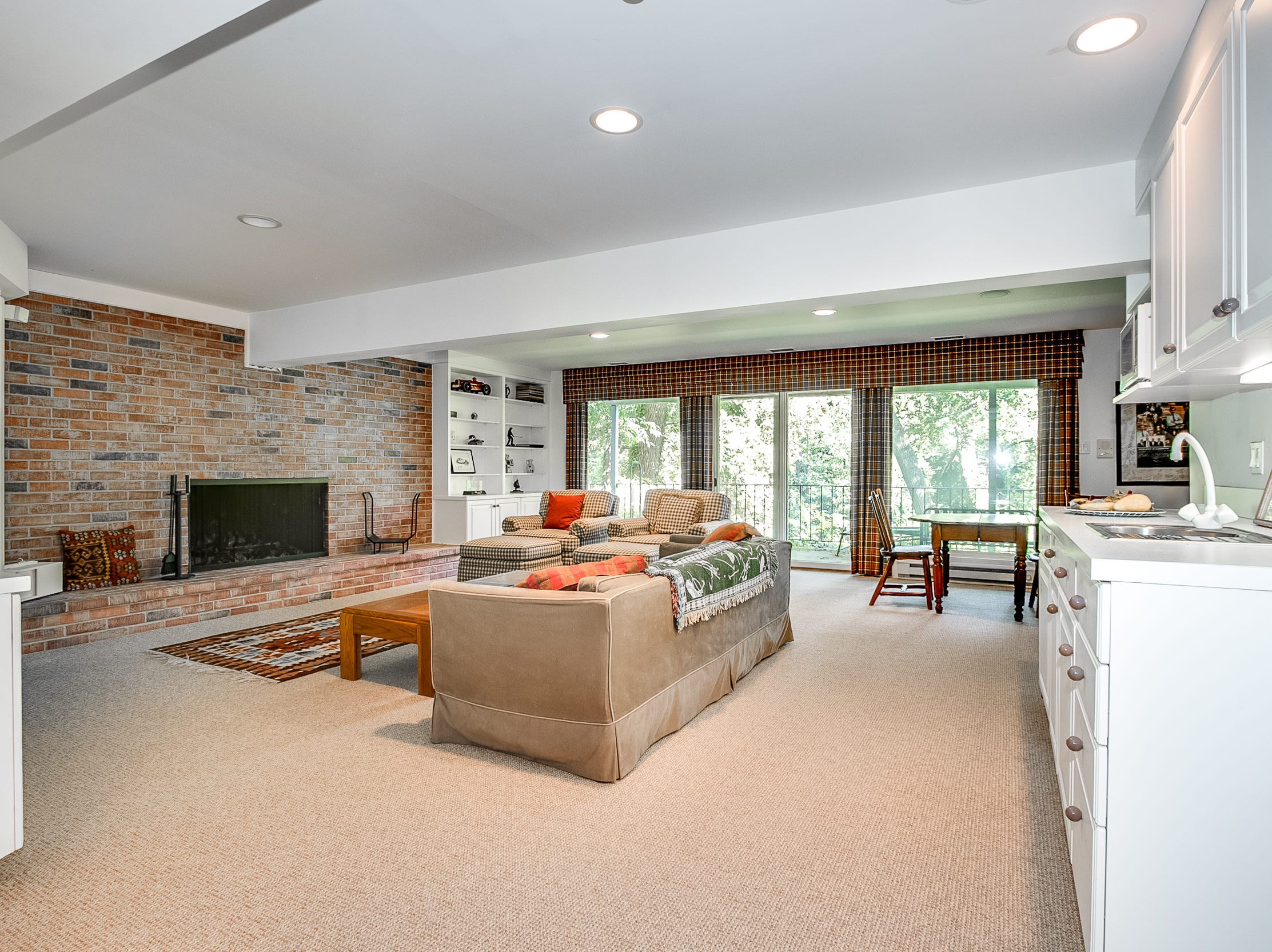 A lower floor family room features one of the house's three fireplaces at 7 Brandywine Falls Road in Wilmington.