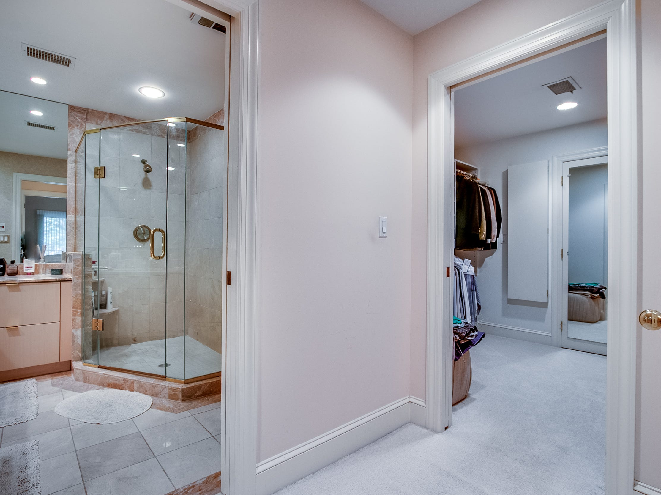 A dressing area with built-in storage connects the master bedroom to the bath at 7 Brandywine Falls Road in Wilmington.