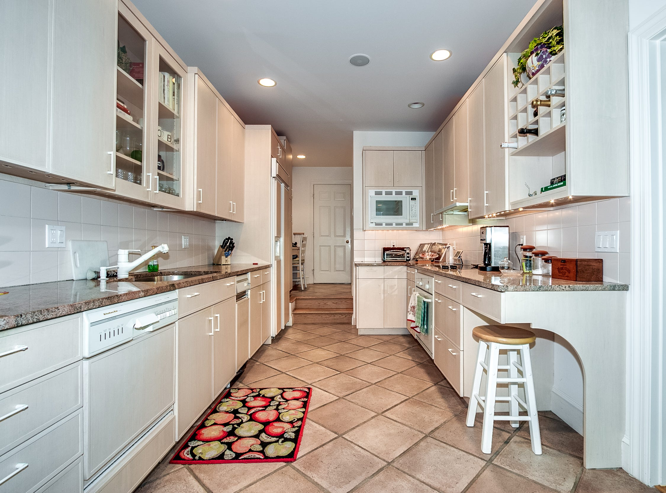 A galley-style kitchen features granite countertops at 7 Brandywine Falls Road in Wilmington.