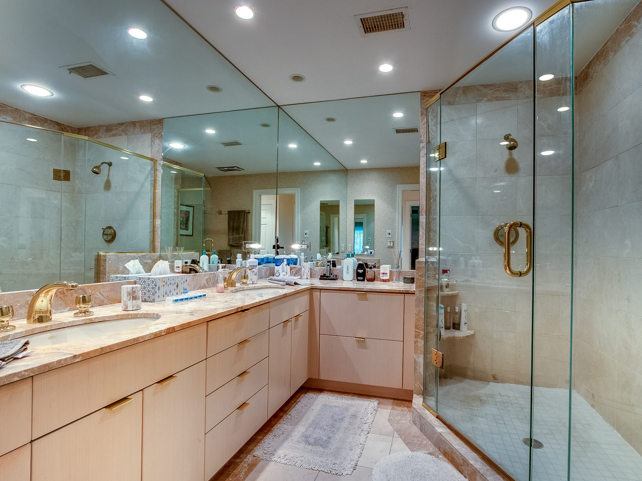 The master bath at 7 Brandywine Falls Road in Wilmington has two sinks and a large shower.