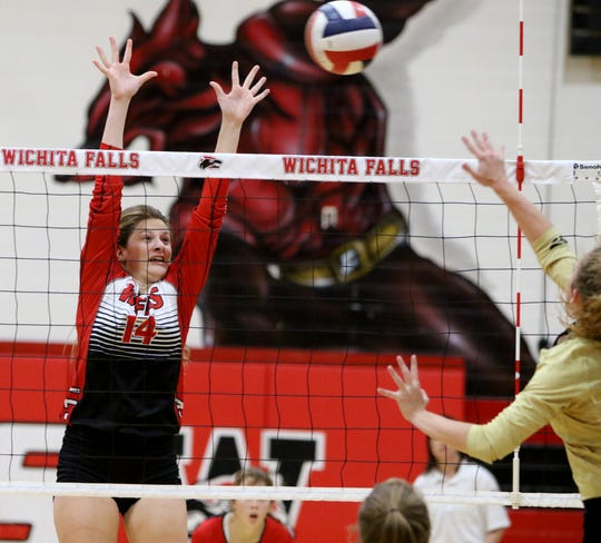 Wichita Falls High School's Lauren Trainer jumps to try to block the ball in the match against Rider Friday, Oct. 5, 2018, at Old High.