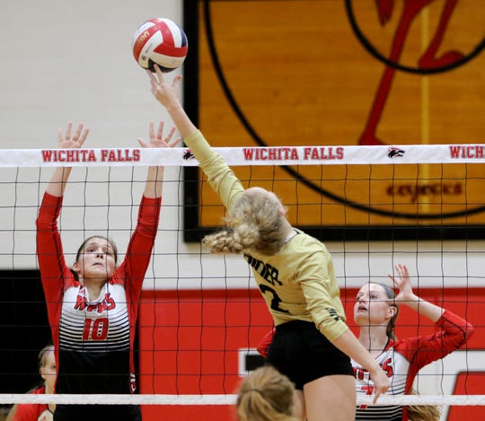 Rider's Lindsey Dodson hits the ball over the reach of Wichita Falls High School's Emma Kuhrt Friday, Oct. 5, 2018, at Old High.
