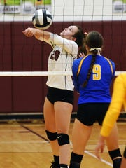 Abby Dickson sets up a teammate during John Glenn's four-set win against Maysville on Thursday in New Concord.