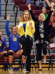Maysville coach Katie Brown celebrates a point during the second set in her team's four-set loss to host John Glenn on Thursday in New Concord.