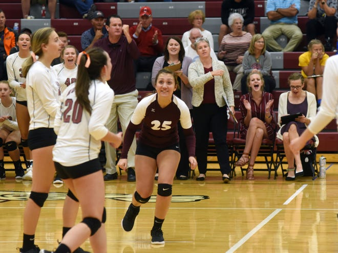 John Glenn celebrates after clinching a 25-18, 18-25, 25-16, 27-25 win against Maysville on Thursday in New Concord. The win kept the Muskies tied atop the Muskingum Valley League standings.