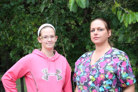 Brandy Reger (left) and Lauralie Fritz helped rescue the child from the roof.