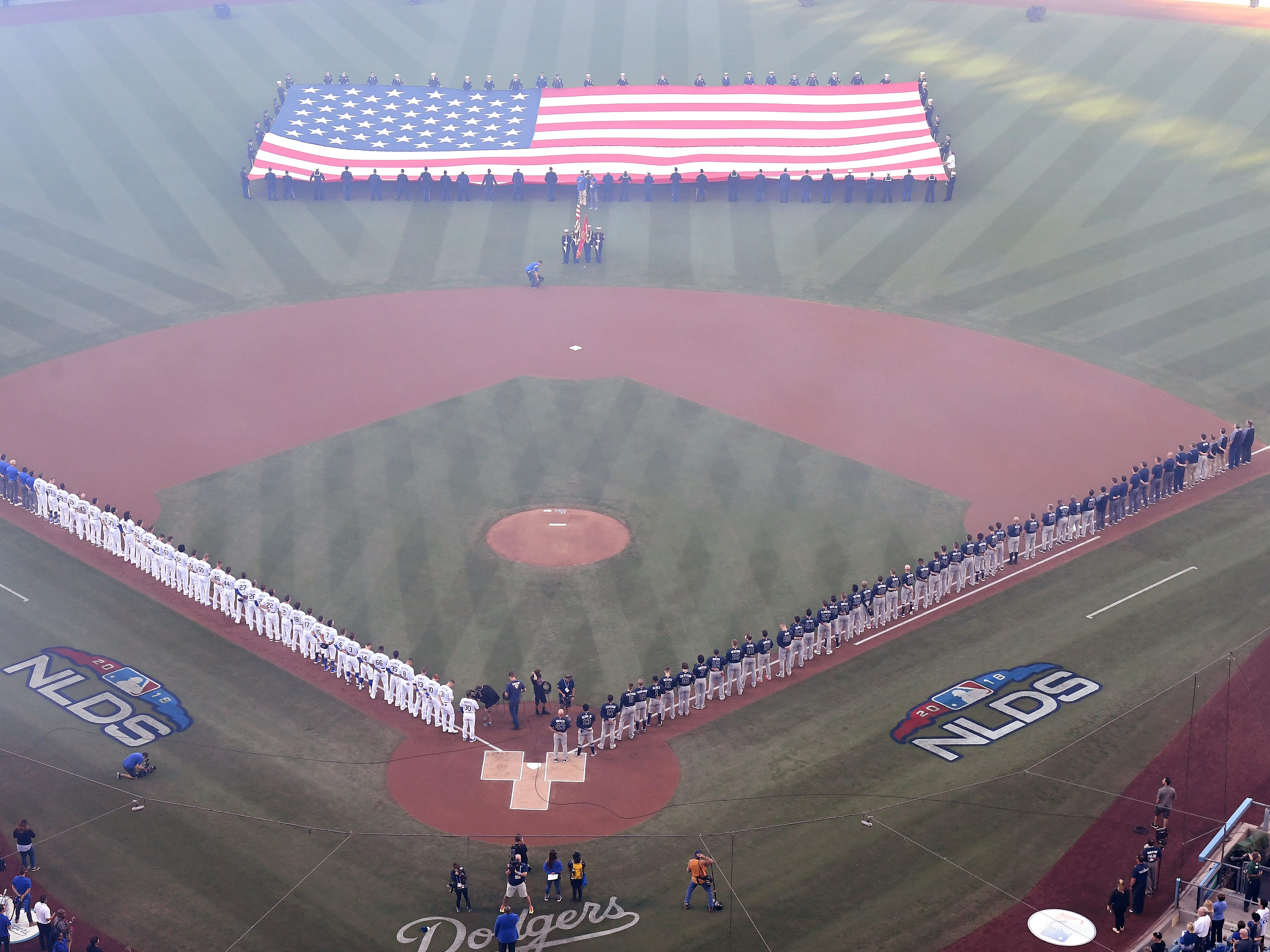 NLDS Game 1: The Dodgers and Braves stand for the national anthem before first pitch at Dodger Stadium.