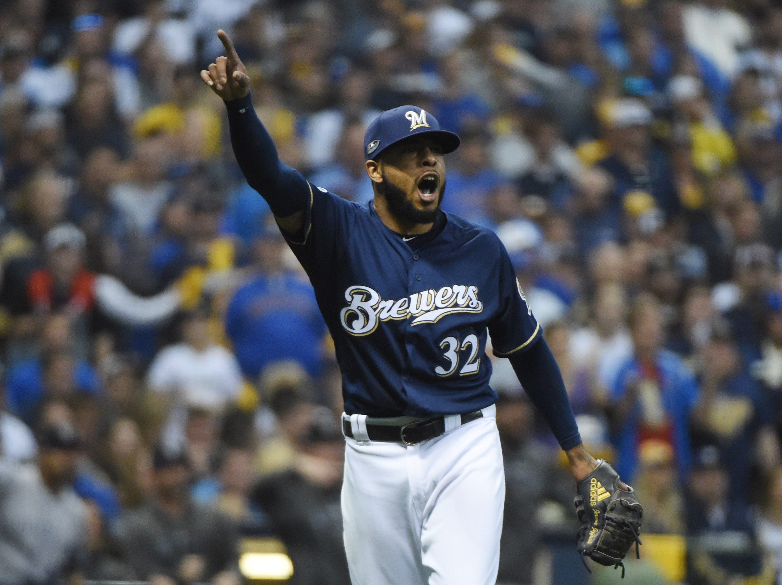 NLDS Game 1: Brewers reliever Jeremy Jeffress reacts to a ball hit by Charlie Blackmon in the ninth inning.