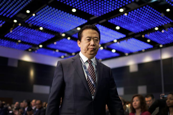 In this July 4, 2017 file photo, Interpol President, Meng Hongwei, walks toward the stage to deliver his opening address at the Interpol World congress in Singapore.