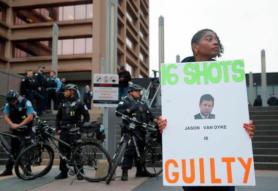 Rena Shepherd stands outside the Leighton Criminal Court Building after the announcement of the guilty verdict in the murder trial of Chicago Police Officer Jason Van Dyke for the 2014 shooting death of 17-year-old Laquan McDonald.