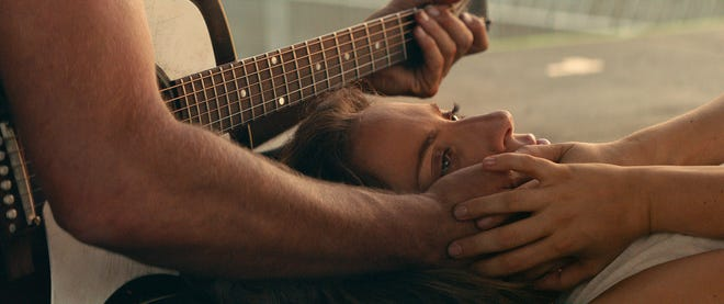 "Ally (Lady Gaga) has a romantic moment with Jackson Maine (Bradley Cooper) in ""A Star Is Born."""