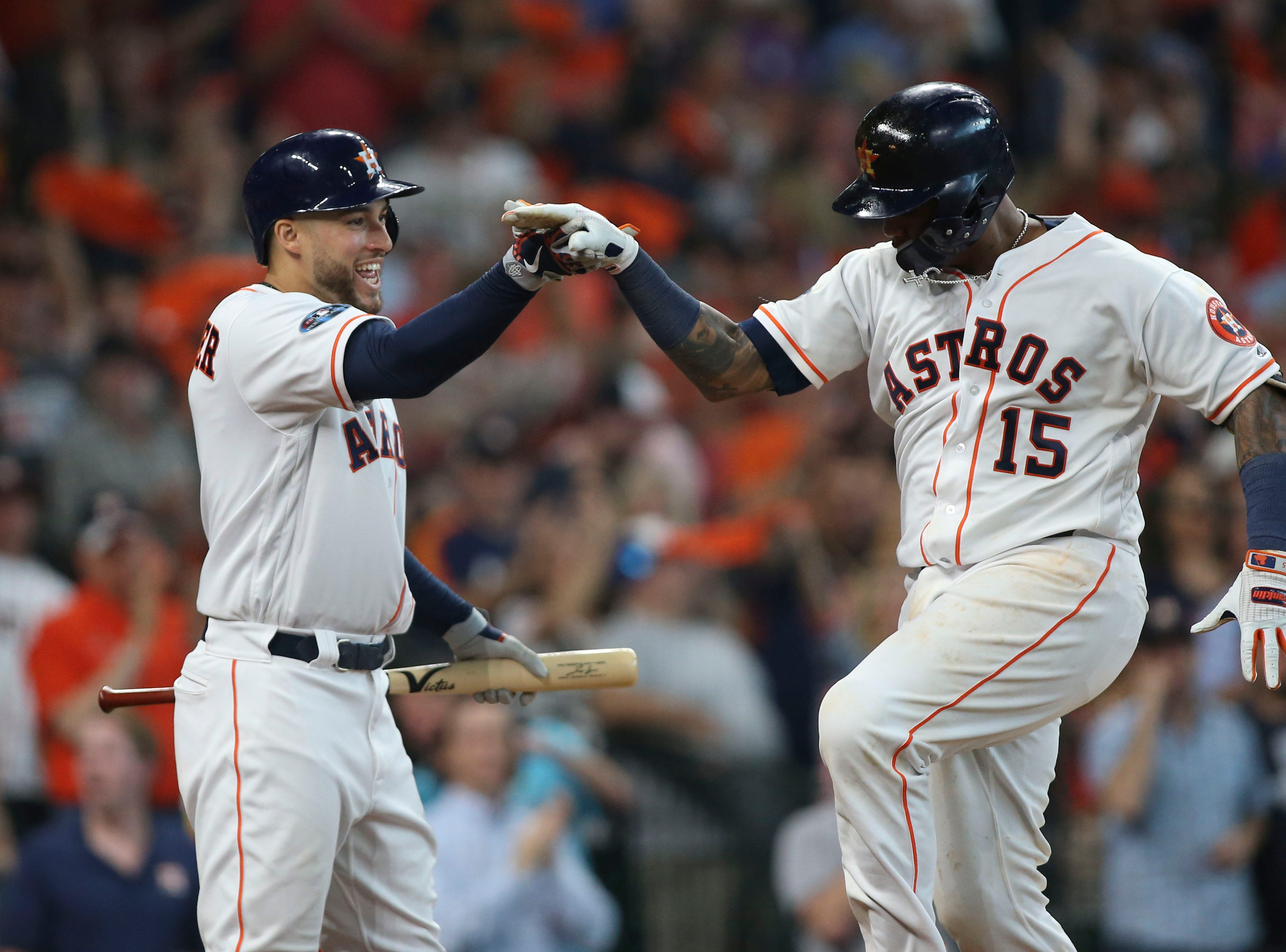 ALDS Game 1: Astros catcher Martin Maldonado is congratulated by George Springer after hitting a solo home run in the seventh inning.