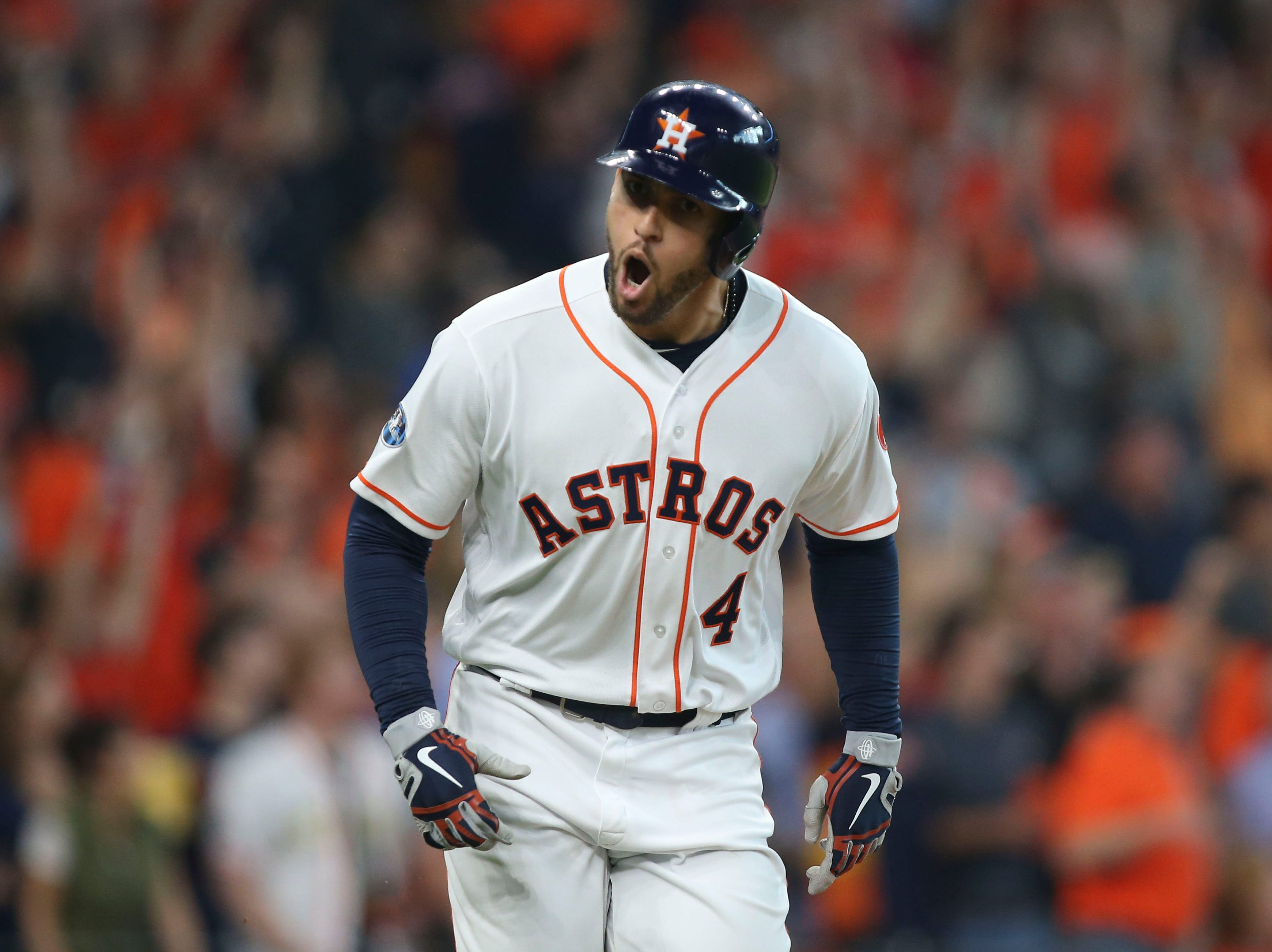 ALDS Game 1: Astros center fielder George Springer celebrates after hitting a solo home run during the fifth inning.