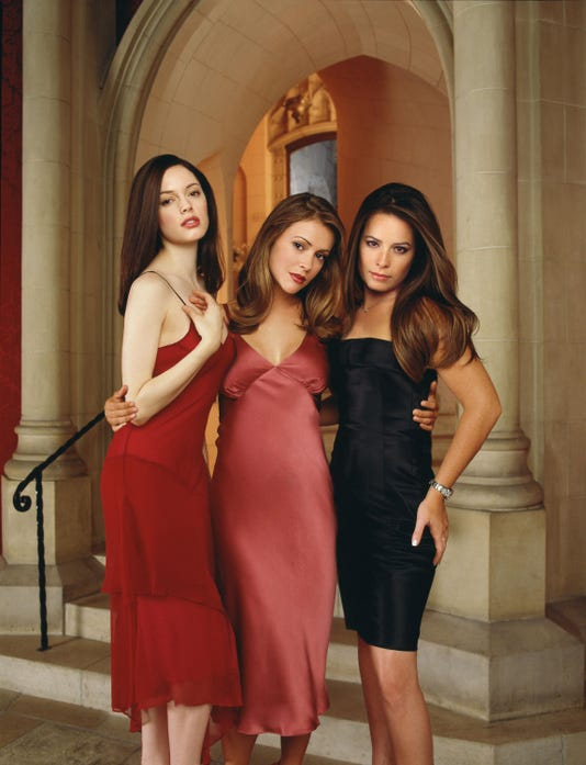 "Rose McGowan as Paige Matthews, Alyssa Milano as Phoebe Halliwell and Holly Marie Combs as Piper Halliwell on ""Charmed.""(Photo: Andrew MacPherson/WB)"