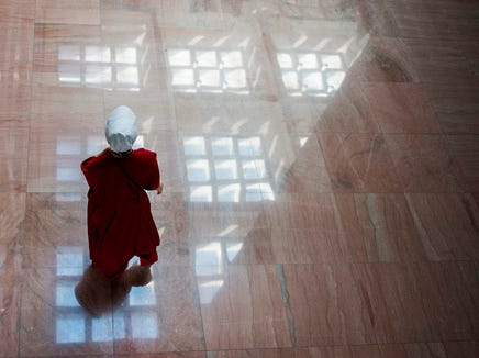 "A protester dressed as a character from the novel-turned-TV series ""The Handmaid's Tale"" walks into the Senate Hart building during a rally against Supreme Court nominee Brett Kavanaugh on Capitol Hill in Washington, DC on October 4, 2018."