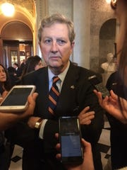 Sen. John Kennedy, R-La., speaks to reporters outside the Senate chamber Oct. 5, 2018.