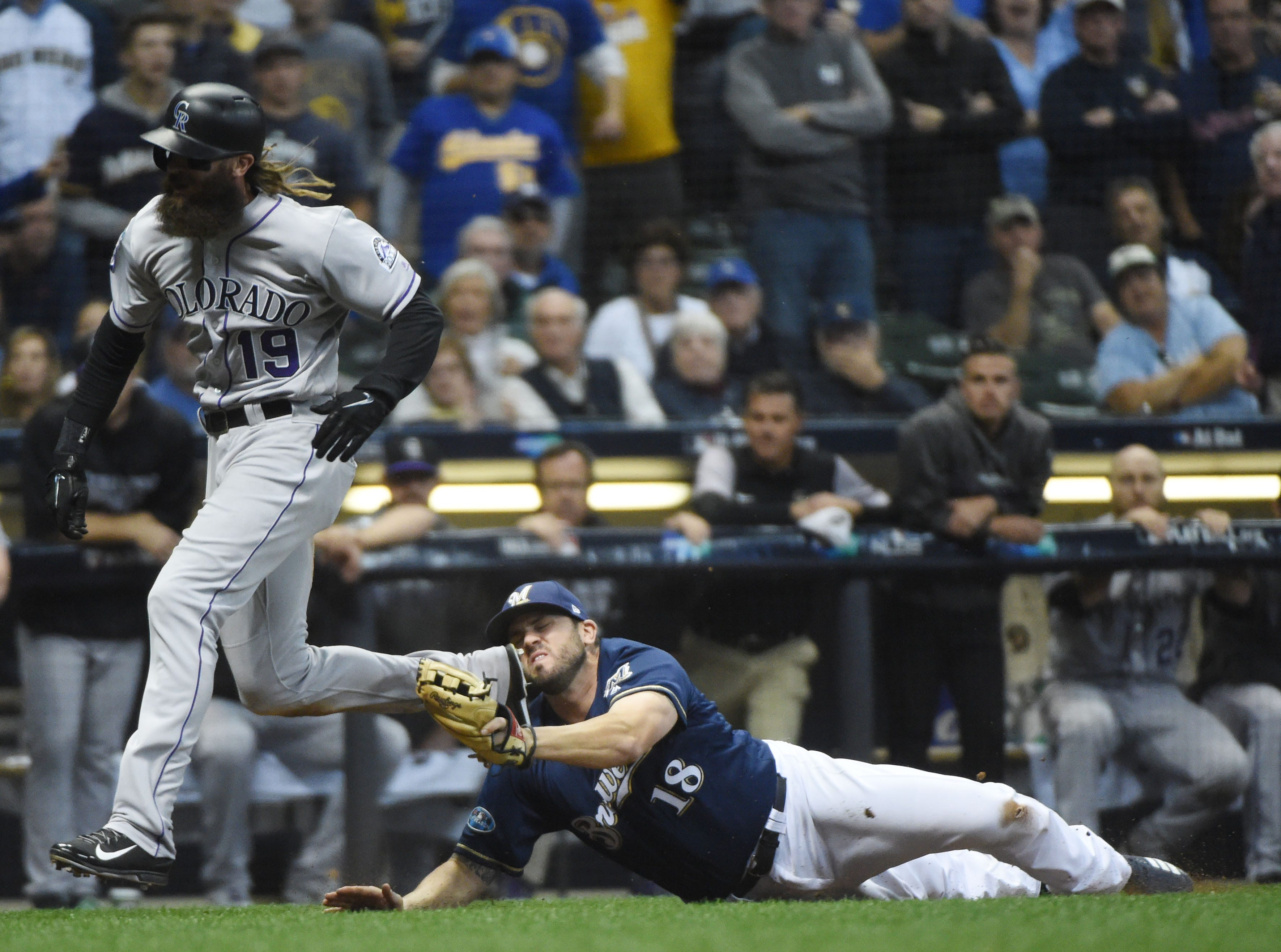 NLDS Game 1: Colorado's Charlie Blackmon is tagged out by Brewers third baseman Mike Moustakas in the ninth inning.