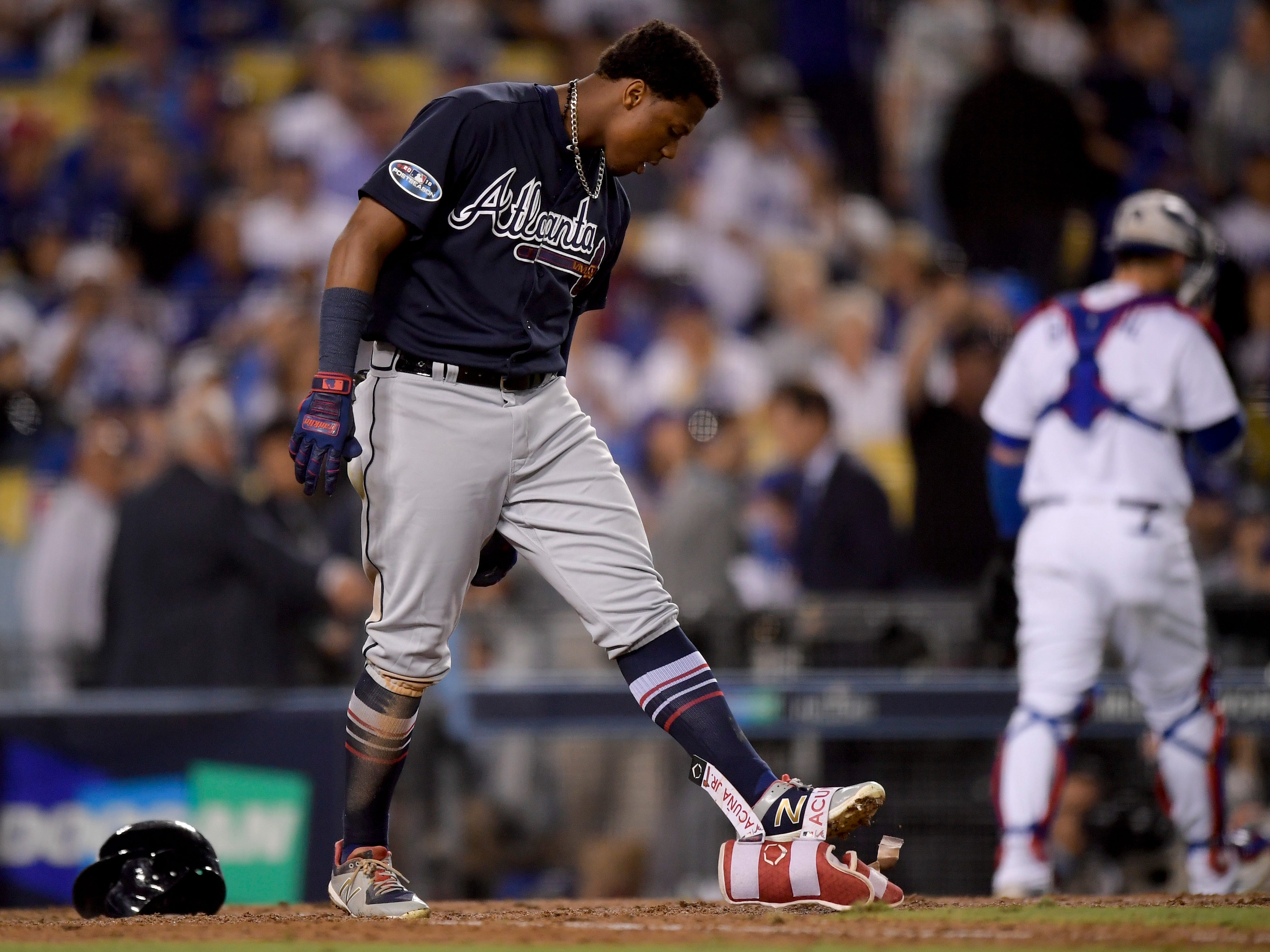 NLDS Game 1: Braves' Ronald Acuna Jr. reacts after striking out in the eighth inning.